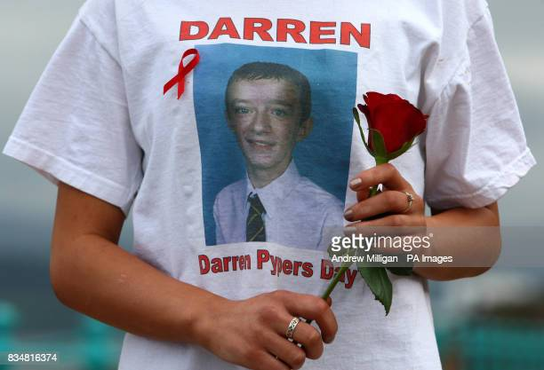 Kendall Gregory friend of stab victim Darren Pyper holds a rose at a march against knife culture in Inverclyde Scotland