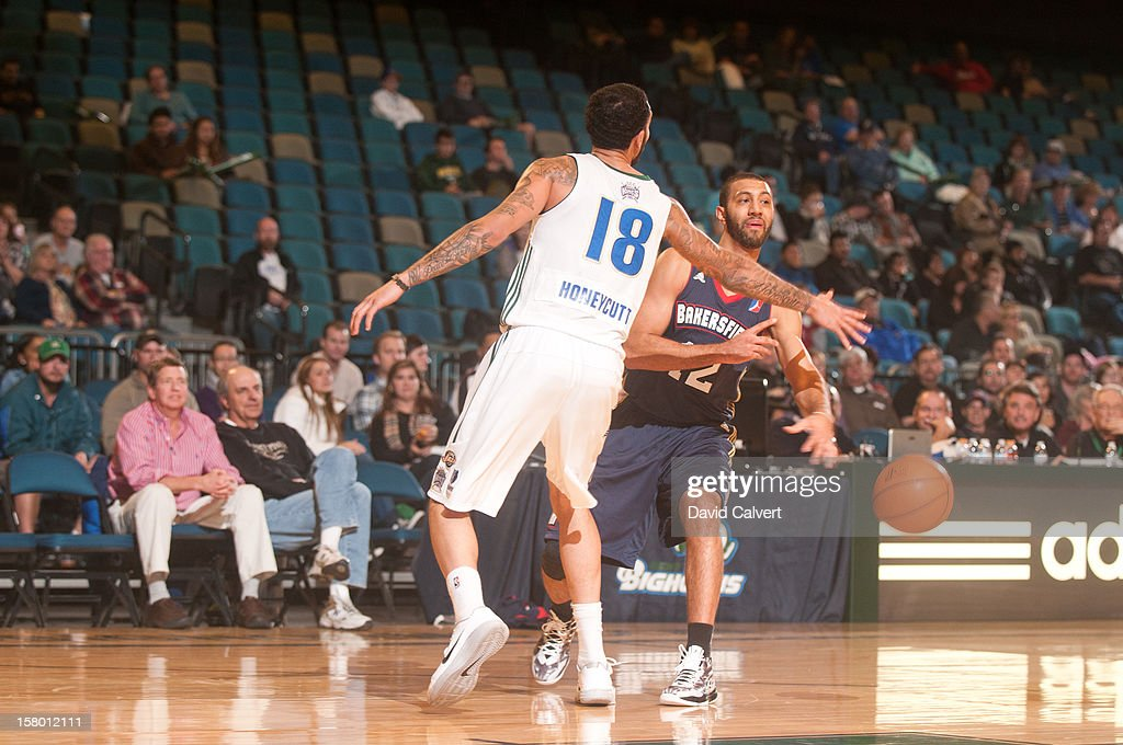 <a gi-track='captionPersonalityLinkClicked' href=/galleries/search?phrase=Kendall+Hunter&family=editorial&specificpeople=4542833 ng-click='$event.stopPropagation()'>Kendall Hunter</a> #12 of the Bakersfield Jam passes around <a gi-track='captionPersonalityLinkClicked' href=/galleries/search?phrase=Tyler+Honeycutt&family=editorial&specificpeople=6569188 ng-click='$event.stopPropagation()'>Tyler Honeycutt</a> #18 of the Reno Bighorns on December 7, 2012 at the Reno Events Center in Reno, Nev..