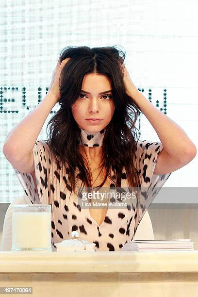 Kendall Jenner adjusts her hair on stage at Westfield Parramatta on November 17 2015 in Sydney Australia