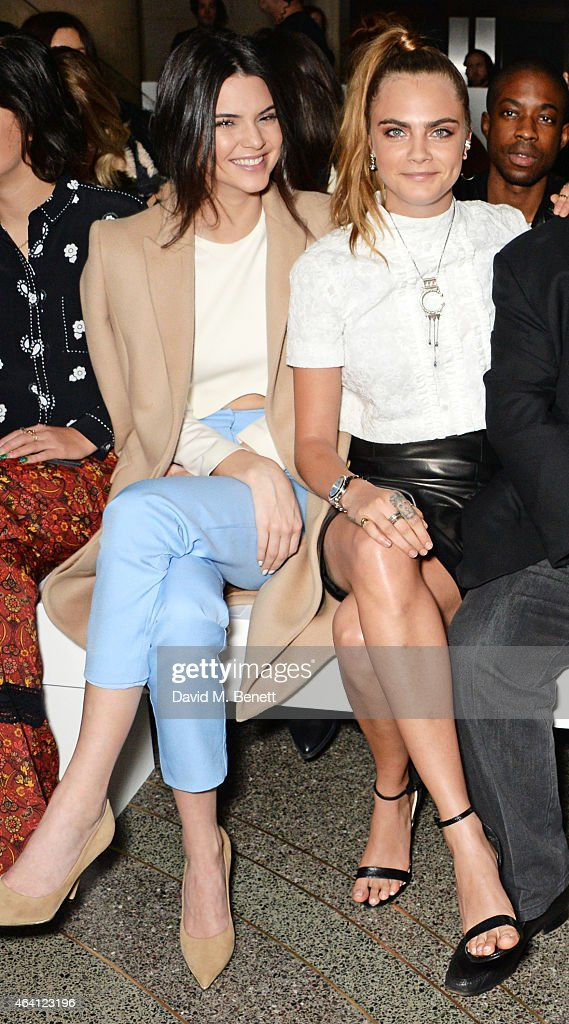 Kendall Jenner (L) and Cara Delevingne attend the Topshop Unique show during London Fashion Week Fall/Winter 2015/16 at Tate Britain on February 22, 2015 in London, England.