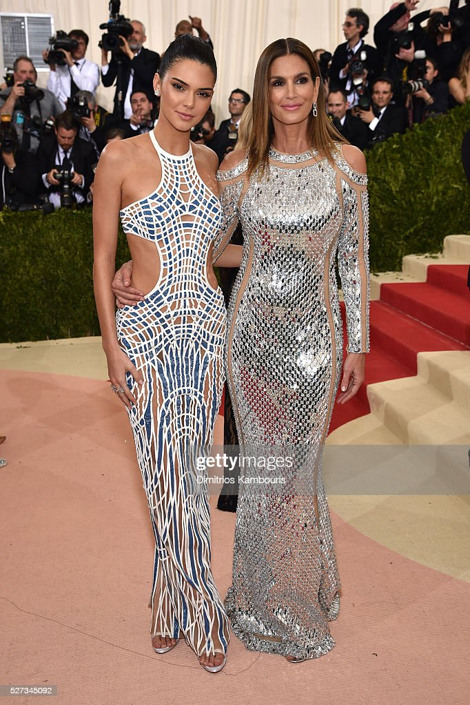 Kendall Jenner (L) and Cindy Crawford attend the 'Manus x Machina: Fashion In An Age Of Technology' Costume Institute Gala at Metropolitan Museum of Art on May 2, 2016 in New York City.