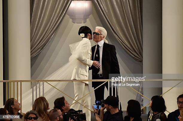 Kendall Jenner and Karl Lagerfeld walk the runway during the Chanel show as part of Paris Fashion Week Haute Couture Fall/Winter 2015/2016 on July 7...