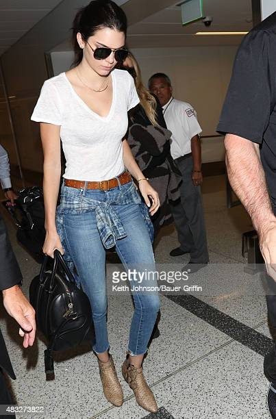 Kendall Jenner and Khloe Kardashian are seen at LAX on August 06 2015 in Los Angeles California