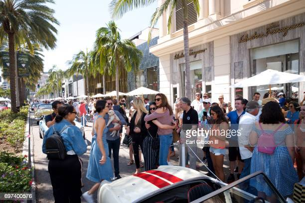 Kendall Jenner and Kylie Jenner greet Caitlyn Jenner at the Rodeo Drive Concours d'Elegance where she displayed her AustinHealey Sprite on June 18...