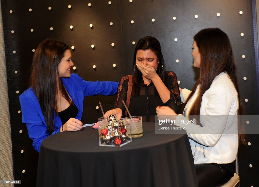Kendall Jenner and Kylie Jenner visits the Kardashian Khaos store at The Mirage Hotel and Casino on December 15, 2012 in Las Vegas, Nevada.