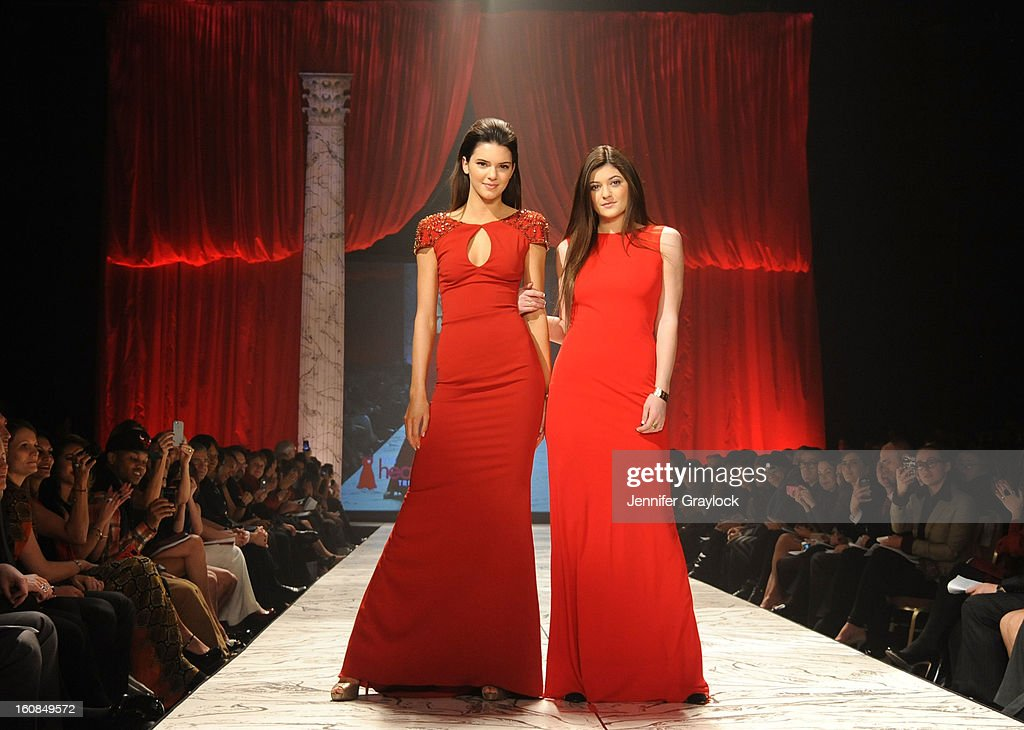 Kendall Jenner and Kylie Jenner wearing Badgley Mischka on the runway during The Heart Truth 2013 Fashion Show held at the Hammerstein Ballroom on February 6, 2013 in New York City.