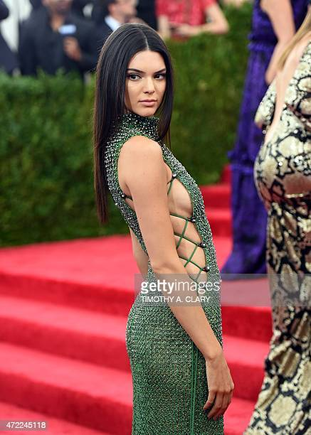 Kendall Jenner arrives at the 2015 Metropolitan Museum of Art's Costume Institute Gala benefit in honor of the museums latest exhibit China Through...
