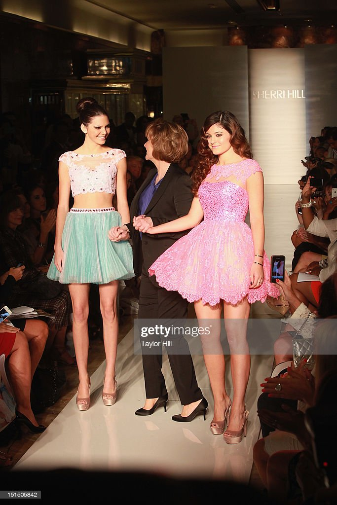 Kendall Jenner, designer Sherri Hill, and Kylie Jenner walk the runway during the Evening Sherri Hill spring 2013 fashion show during Mercedes-Benz Fashion Week at Trump Tower Grand Corridor on September 7, 2012 in New York City.