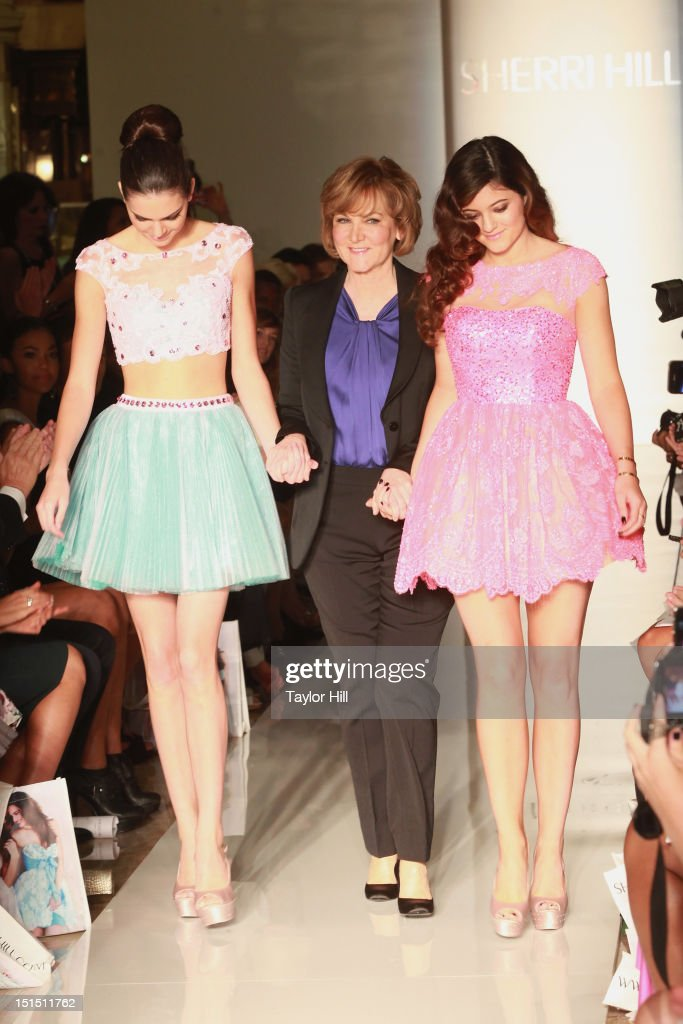 Kendall Jenner, designer Sherri Hill, and Kylie Jenner walk the runway at the Evening Sherri Hill spring 2013 fashion show during Mercedes-Benz Fashion Week at Trump Tower Grand Corridor on September 7, 2012 in New York City.