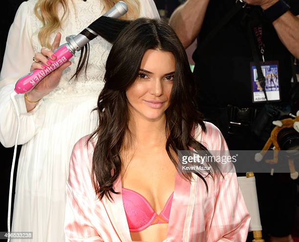 Kendall Jenner gets ready backstage before the 2015 Victoria's Secret Fashion Show at Lexington Armory on November 10 2015 in New York City