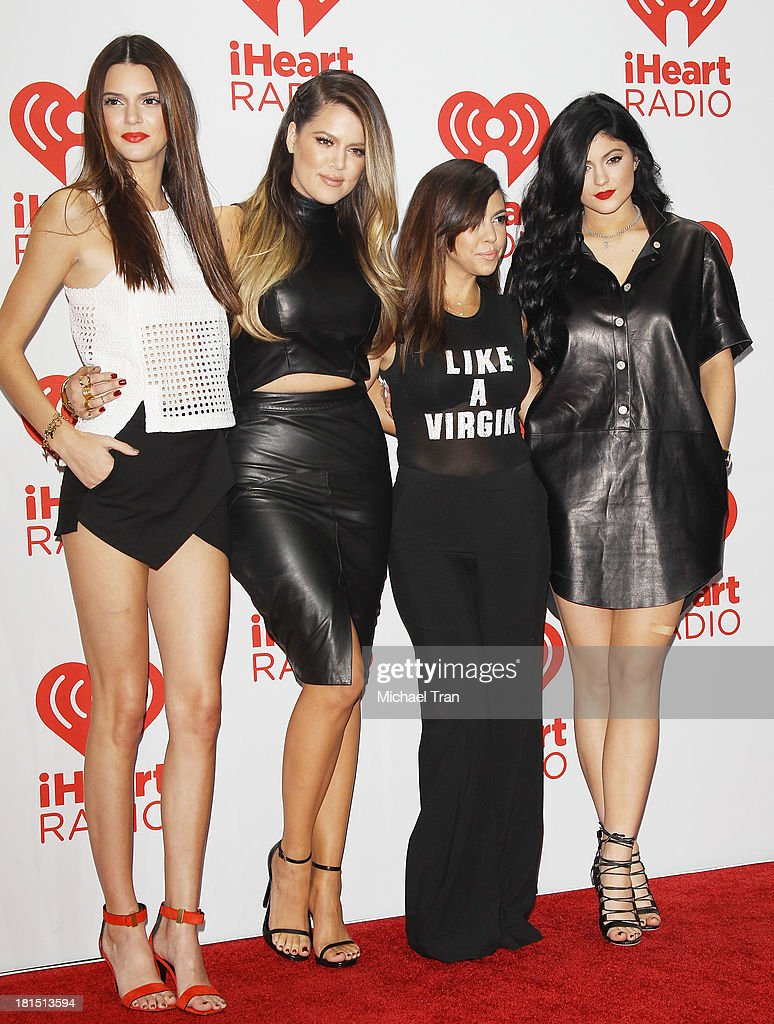 Kendall Jenner, Khloe Kardashian, Kourtney Kardashian and Kylie Jenner arrive at the iHeartRadio Music Festival - press room - Day 2 held on September 21, 2013 in Las Vegas, Nevada.