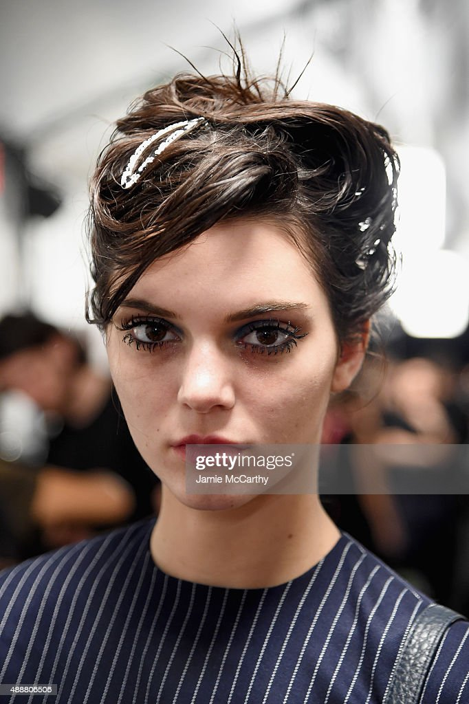 Kendall Jenner prepares backstage at the Marc Jacobs Spring 2016 fashion show during New York Fashion Week at Ziegfeld Theater on September 17 2015...