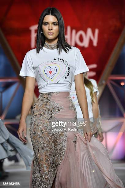 Kendall Jenner walks the runway at the Fashion for Relief during the 70th annual Cannes Film Festival at Aeroport Cannes Mandelieu on May 21 2017 in...
