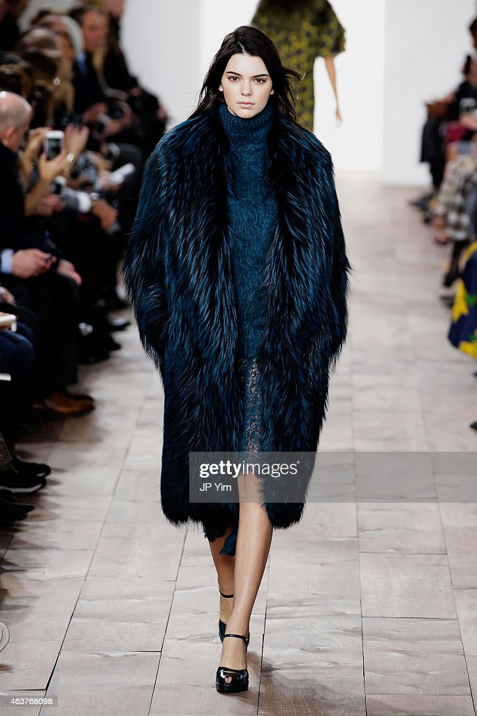 Kendall Jenner walks the runway at the Michael Kors fashion show during MercedesBenz Fashion Week Fall at Spring Studios on February 18 2015 in New...
