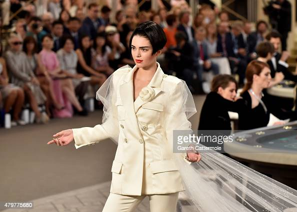 Kendall Jenner walks the runway during the Chanel show as part of Paris Fashion Week Haute Couture Fall/Winter 2015/2016 at the Grand Palais on July...