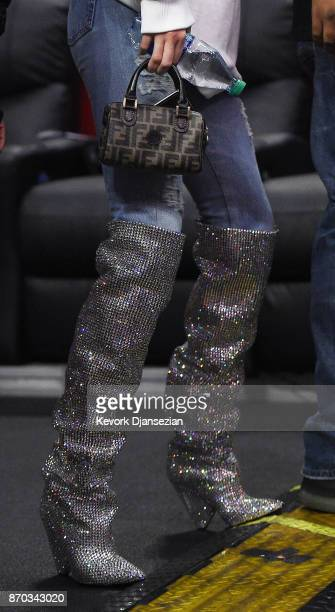 Kendall Jenner wearing a pair of $10000 Saint Laurent boots attends the LA Clippers and Memphis Grizzlies basketball game at Staples Center November...