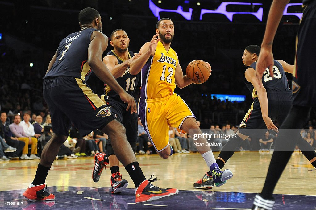 Kendall Marshall #12 of the Los Angeles Lakers dribbles against Tyreke Evans #1 of the New Orleans Pelicans at Staples Center on March 4, 2014 in Los Angeles, California.