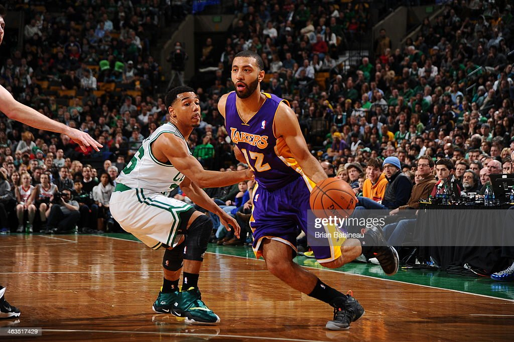 <a gi-track='captionPersonalityLinkClicked' href=/galleries/search?phrase=Kendall+Marshall&family=editorial&specificpeople=6783056 ng-click='$event.stopPropagation()'>Kendall Marshall</a> #12 of the Los Angeles Lakers dribbles to the basket against the Boston Celtics on January 17, 2014 at the TD Garden in Boston, Massachusetts.
