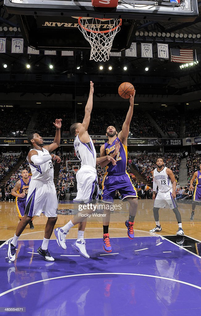 Kendall Marshall #12 of the Los Angeles Lakers puts up a shot against Jared Cunningham #9 of the Sacramento Kings on April 2, 2014 at Sleep Train Arena in Sacramento, California.
