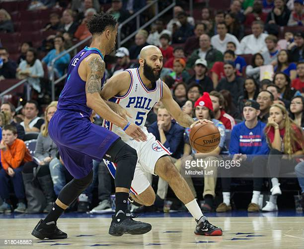 Kendall Marshall of the Philadelphia 76ers controls the ball against Courtney Lee of the Charlotte Hornets on March 29 2016 at the Wells Fargo Center...