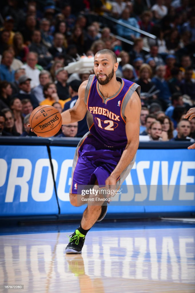 <a gi-track='captionPersonalityLinkClicked' href=/galleries/search?phrase=Kendall+Marshall&family=editorial&specificpeople=6783056 ng-click='$event.stopPropagation()'>Kendall Marshall</a> #12 of the Phoenix Suns brings the ball up court against the Denver Nuggets on April 17, 2013 at the Pepsi Center in Denver, Colorado.