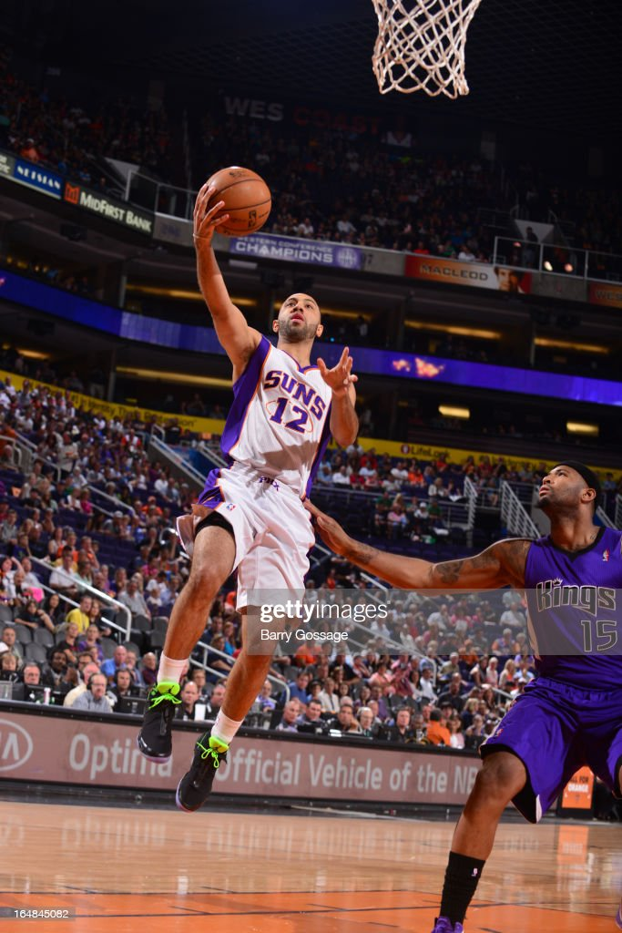 Kendall Marshall #12 of the Phoenix Suns drives for the layup against the Sacramento Kings on March 28, 2013 at U.S. Airways Center in Phoenix, Arizona.