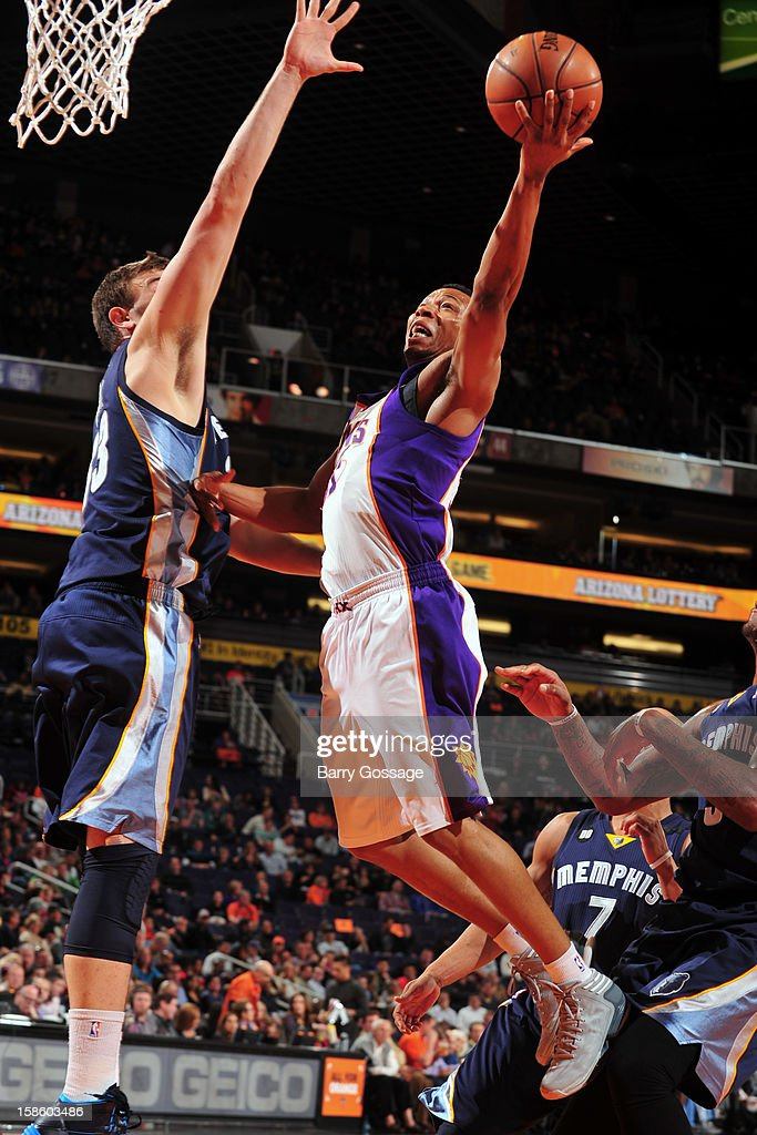 <a gi-track='captionPersonalityLinkClicked' href=/galleries/search?phrase=Kendall+Marshall&family=editorial&specificpeople=6783056 ng-click='$event.stopPropagation()'>Kendall Marshall</a> #12 of the Phoenix Suns drives to the basket against the Memphis Grizzlies on December 12, 2012 at U.S. Airways Center in Phoenix, Arizona.
