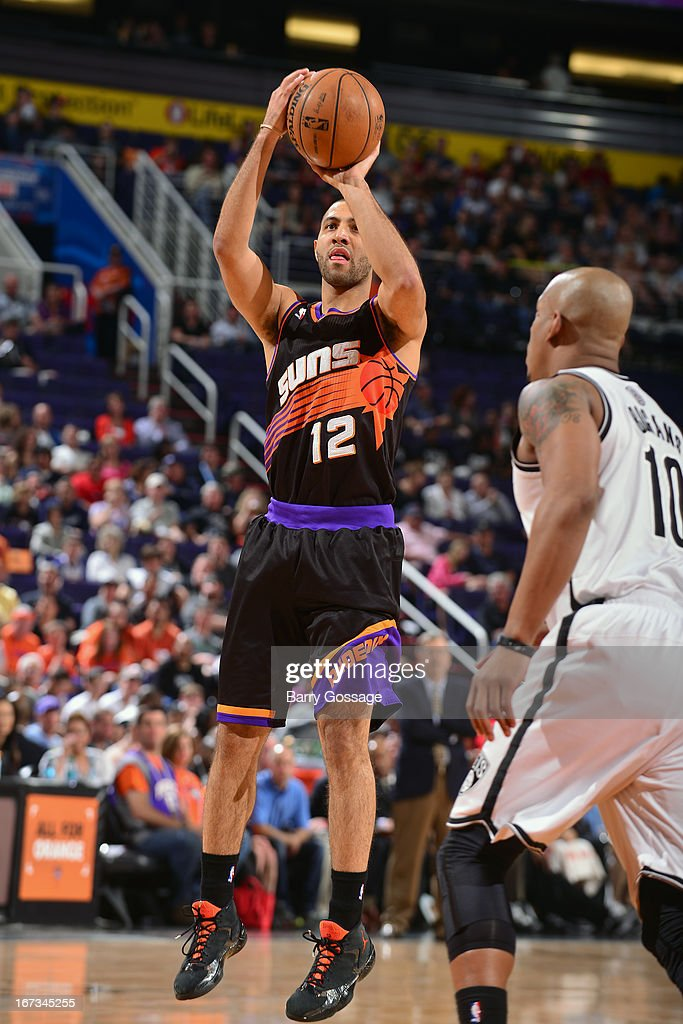 <a gi-track='captionPersonalityLinkClicked' href=/galleries/search?phrase=Kendall+Marshall&family=editorial&specificpeople=6783056 ng-click='$event.stopPropagation()'>Kendall Marshall</a> #12 of the Phoenix Suns shoots the bal against the Brooklyn Nets on March 24, 2013 at U.S. Airways Center in Phoenix, Arizona.