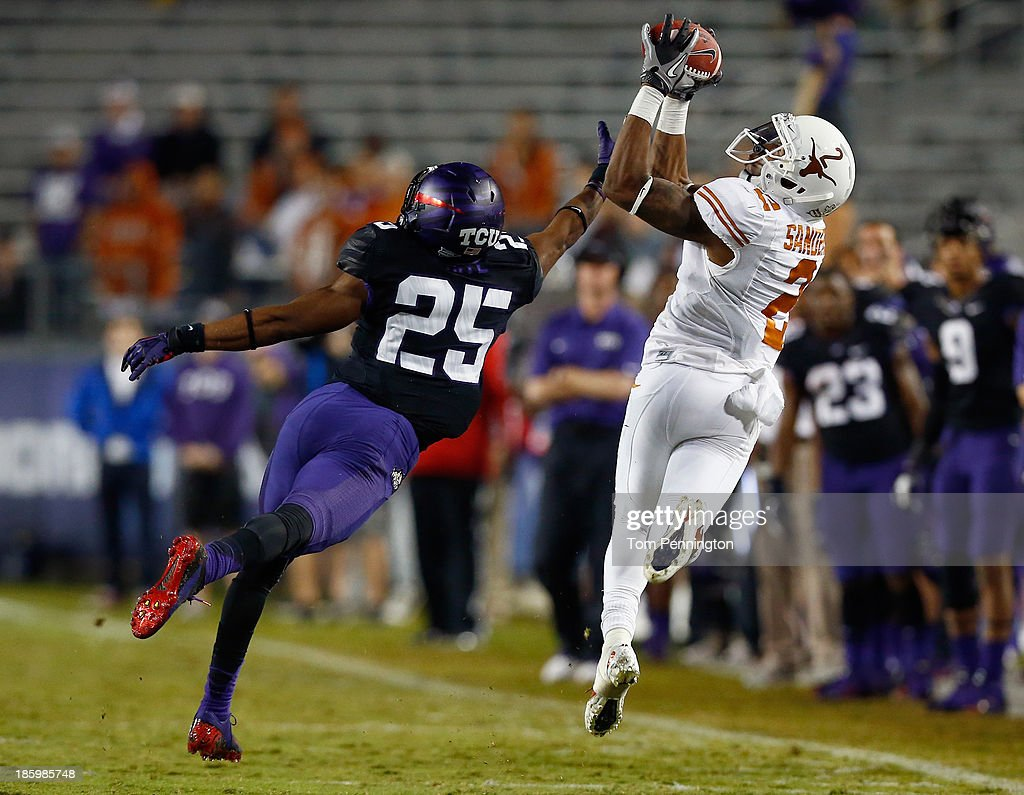 Kendall Sanders #2 of the Texas Longhorns pulls in a pass against Kevin White #25 of the TCU Horned Frogs in the third quarter at Amon G. Carter Stadium on October 26, 2013 in Fort Worth, Texas.