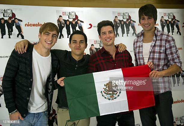 Kendall Schmidt Carlos Pena Logan Herderson and James Maslow members of the US Big Time Rush group pose with a Mexican National flag during a photo...