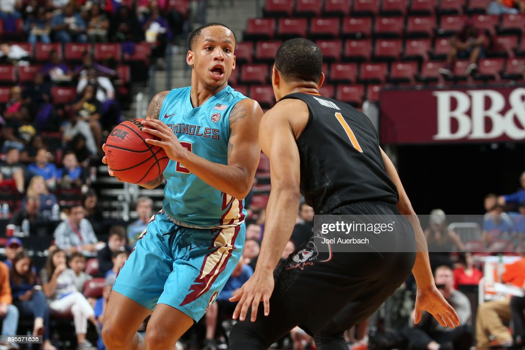 Kendall Smith #1 of the Oklahoma State Cowboys defends against CJ Walker #2 of the Florida State Seminoles during the MetroPCS Orange Bowl Basketball Classic on December 16, 2017 at the BB&T Center in Sunrise, Florida. Oklahoma State defeated Florida State 71-70.