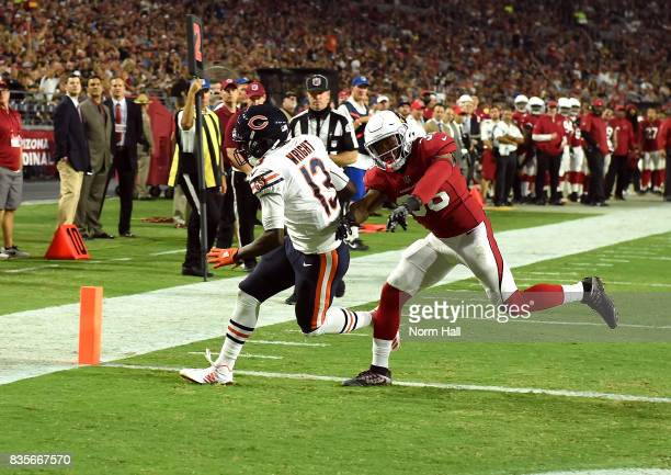 Kendall Wright of the Chicago Bears catches a touchdown pass during the first half while being defended by Budda Baker of the Arizona Cardinals at...
