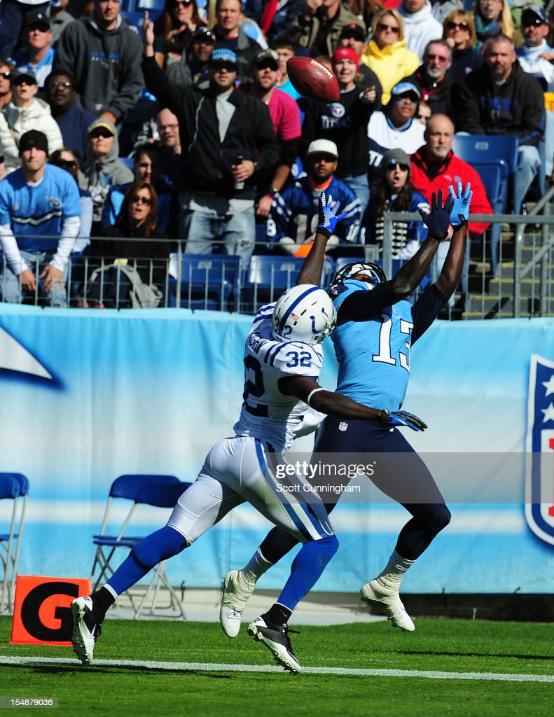 <a gi-track='captionPersonalityLinkClicked' href=/galleries/search?phrase=Kendall+Wright&family=editorial&specificpeople=5556154 ng-click='$event.stopPropagation()'>Kendall Wright</a> #13 of the Tennessee Titans makes a catch for a touchdown against Cassius Vaughn #32 of the Indianapolis Colts at LP Field on October 28, 2012 in Nashville, Tennessee.