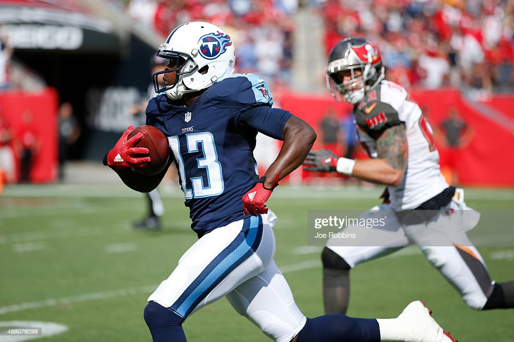 Kendall Wright #13 of the Tennessee Titans takes a pass for a 52-yard touchdown against the Tampa Bay Buccaneers in the first quarter at Raymond James Stadium on September 13, 2015 in Tampa, Florida.