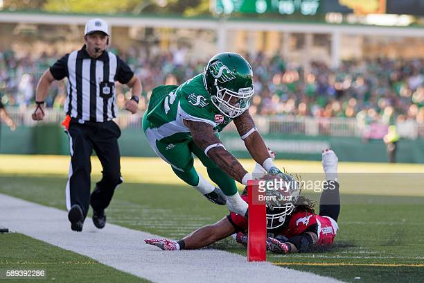 Kendial Lawrence of the Saskatchewan Roughriders reaches for the goal line during first half action of the game between the Calgary Stampeders and...