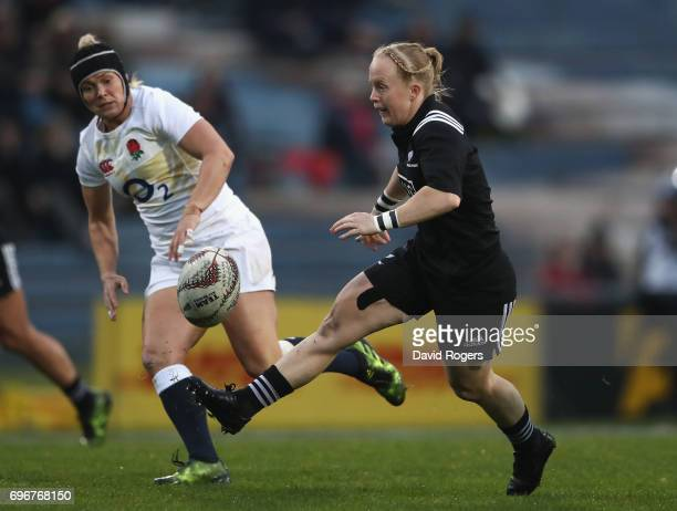 Kendra Cocksedge of New Zealand kicks the ball through to score their firs try during the International Test match between the New Zealand Black...