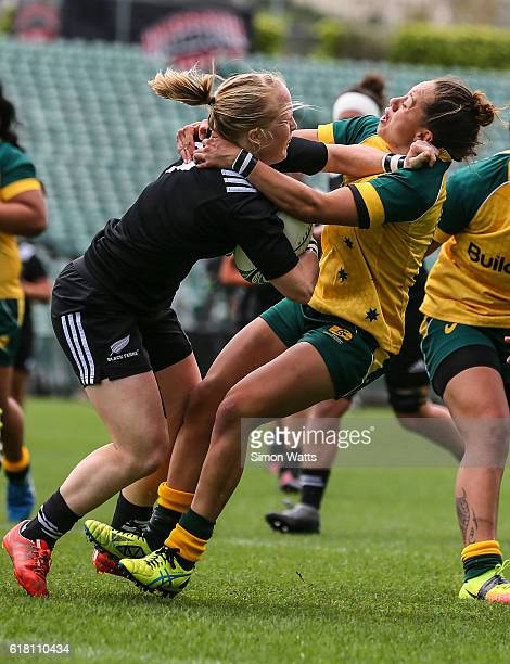 Kendra Cocksedge of the Black Ferns is tacken high by Cobie Jane Morgan of the Wallaroos during the International Test match between the New Zealand...