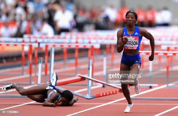Kendra Harrison of the United States wins the Womens 100m hurdles final as Jasmin Stowers of the United States craahes into her hurdle during the...