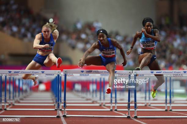 Kendra Harrison of USA clears the final hurdle on her way to victory in the the women's 100m hurdles from Sally Pearson of Australia and Jasmin...