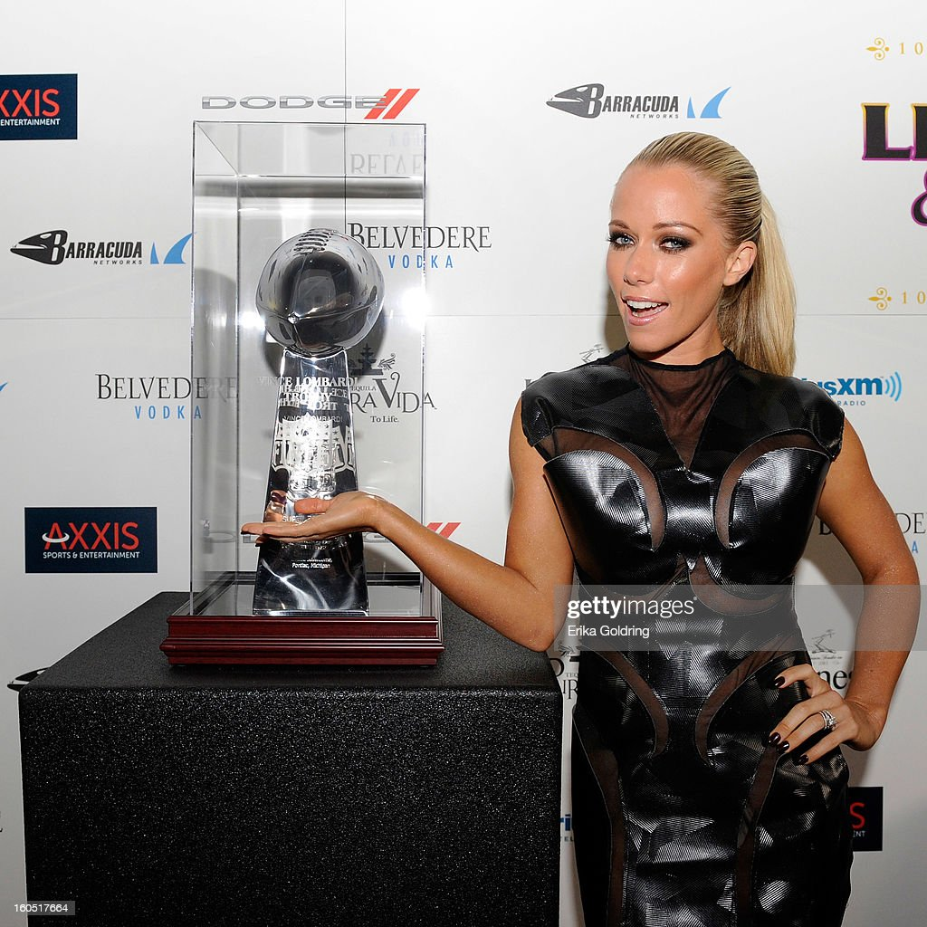 Kendra Wilkinson poses with the Lombardi Trophy at the Tenth Annual Leather & Laces Super Bowl Party on February 1, 2013 in New Orleans, Louisiana.