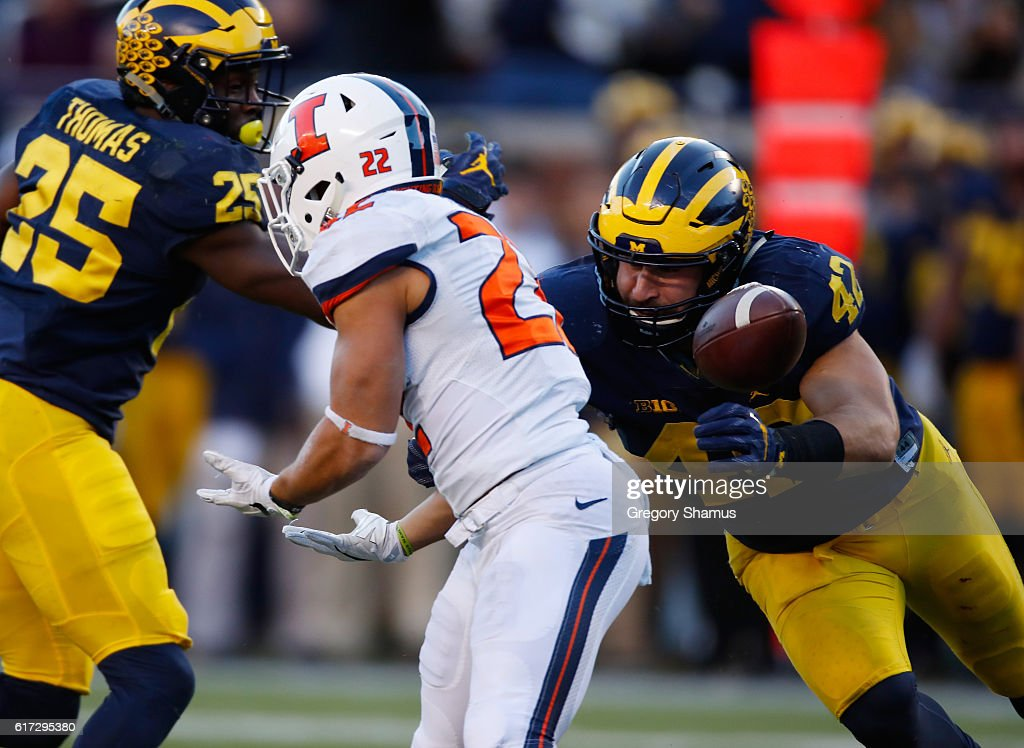 Kendrick Foster #22 of the Illinois Fighting Illini can't come up with a third quarter catch next to Ben Gedeon #42 of the Michigan Wolverines on October 22, 2016 at Michigan Stadium in Ann Arbor, Michigan. Michigan won the game 41-8.