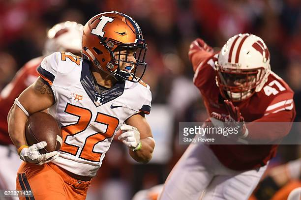 Kendrick Foster of the Illinois Fighting Illini is pursued by Vince Biegel of the Wisconsin Badgers during the second half of a game at Camp Randall...