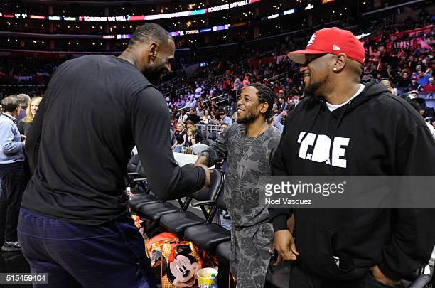 Kendrick Lamar greets LeBron James at a basketball game between the Cleveland Cavaliers and the Los Angeles Clippers at Staples Center on March 13...