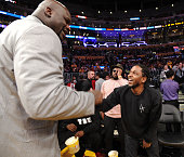 Kendrick Lamar greets Shaquille O'Neal at a basketball game between the Utah Jazz and the Los Angeles Lakers at Staples Center on April 13 2016 in...