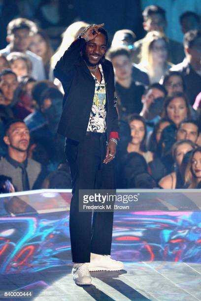 Kendrick Lamar poses onstage during the 2017 MTV Video Music Awards at The Forum on August 27 2017 in Inglewood California