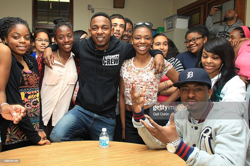 <a gi-track='captionPersonalityLinkClicked' href=/galleries/search?phrase=Kendrick+Lamar&family=editorial&specificpeople=8012417 ng-click='$event.stopPropagation()'>Kendrick Lamar</a> (C) visits Providence, Rhode Island students in their classroom during the Get Schooled victory tour at the Mt. Pleasant High School on May 10, 2013 in Providence, Rhode Island.