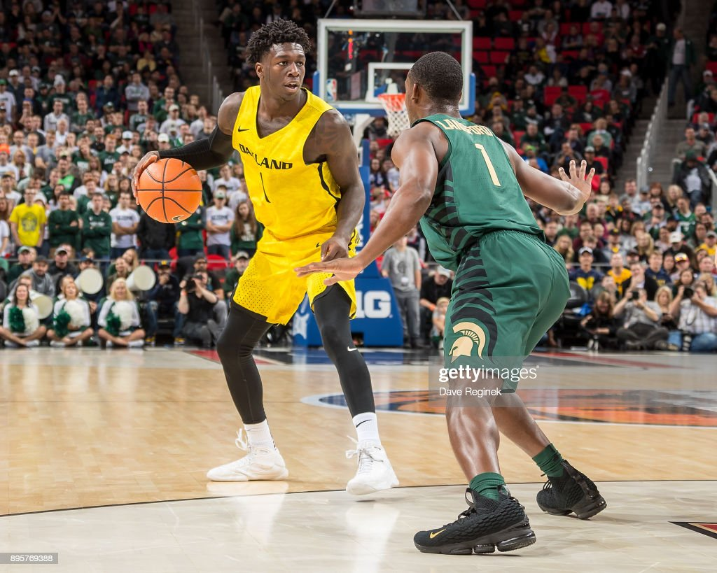 Kendrick Nunn #1 of the Oakland Golden Grizzlies controls the ball in front of Joshua Langford #1 of the Michigan State Spartans during game two of the Hitachi College Basketball Showcase at Little Caesars Arena on December 16, 2017 in Detroit, Michigan. The Spartans defeated the Grizzles 86-73.