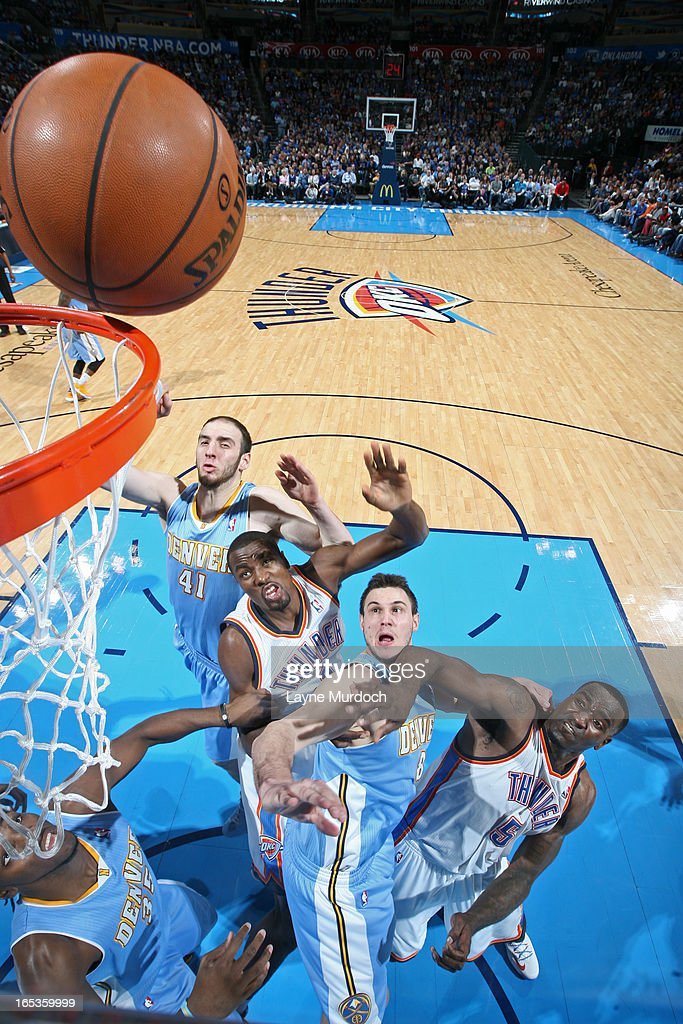 Kendrick Perkins #5 and Serge Ibaka #9 of the Oklahoma City Thunder go up for a rebound against Kosta Koufos #41a and Danilo Gallinari #8 of the Denver Nuggets on March 19, 2013 at the Chesapeake Energy Arena in Oklahoma City, Oklahoma.