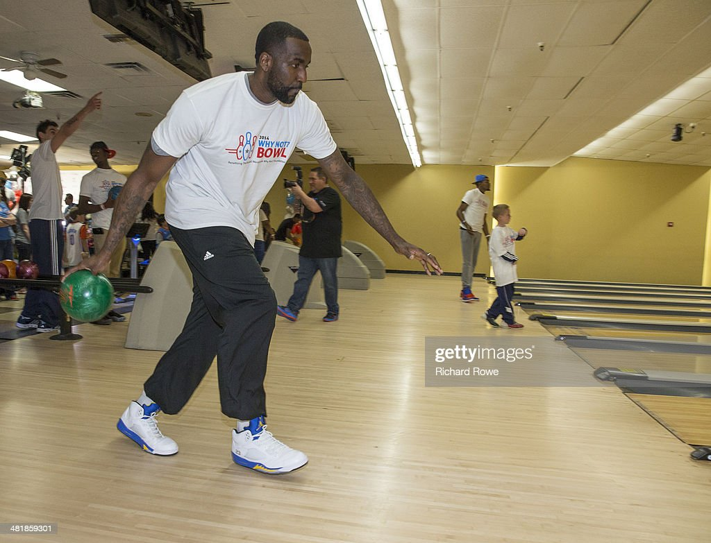 Kendrick Perkins #5 joins Russell Westbrook #0 of the Oklahoma City Thunder at his annual Why Not Foundation fundraiser to benefit the Boys and Girls Club at AMC Boulevard Bowl in Edmond, Oklahoma.