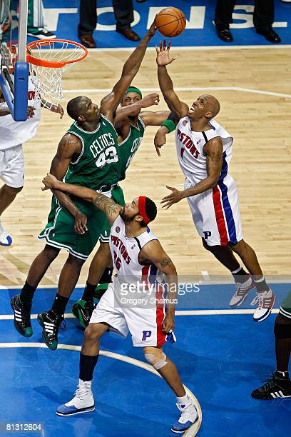 Kendrick Perkins of the Boston Celtics blocks the shot of Chauncey Billups of the Detroit Pistons during Game Six of the Eastern Conference finals...